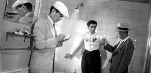 Another scene from Stray Dog, Sato and Murakami interrogate a small time gangster in a hotel bathroom