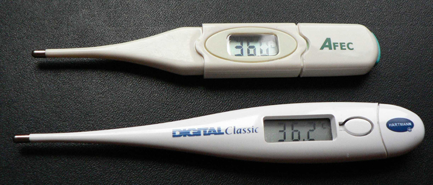 A photograph showing two digital thermometers used for measuring body temperature.