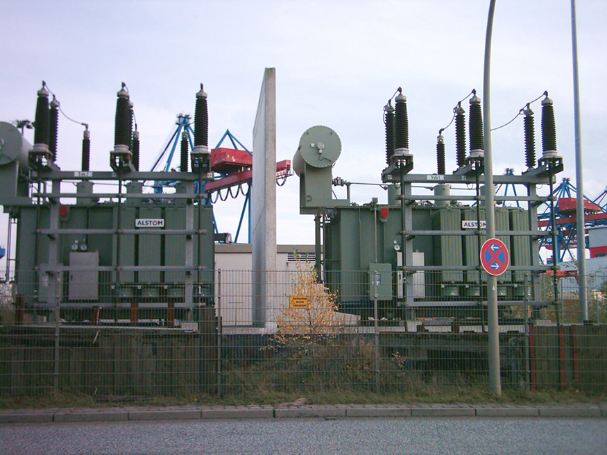 Photograph of transformers installed in transmission lines.