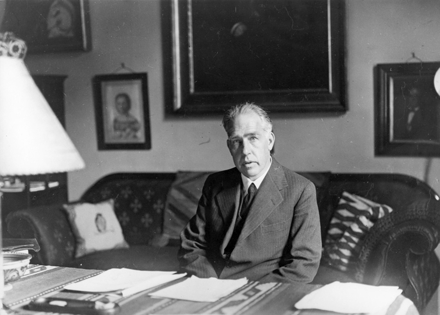A photograph of Niels Bohr.