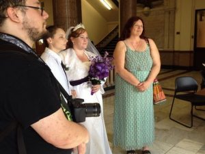 Photo of two women getting married in Wayne County. Photo taken by Louise Ronald of the Pal-Item.