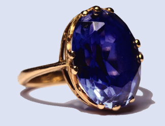 This is a photograph of a ring with a sapphire set in it.