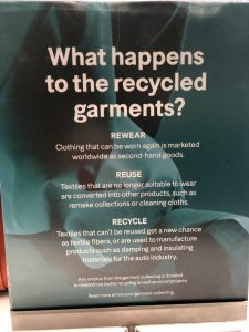 The sign for the H&M Garment Collection Program, describing how clothes are reworn, reused, or recycled